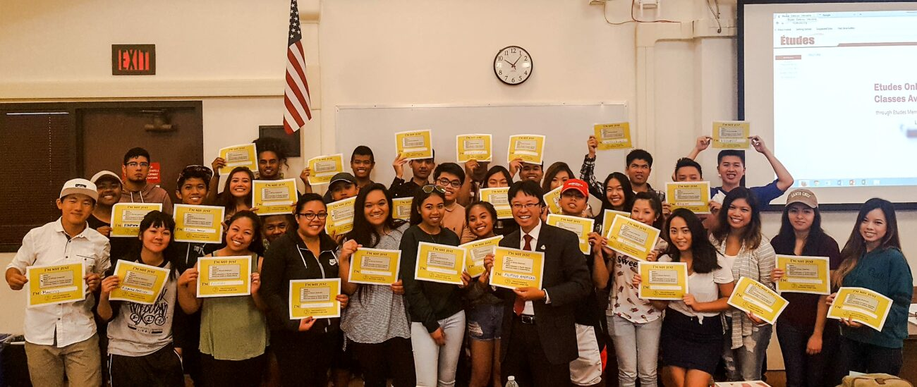 Commissioner Villavicencio and Delta College students with data disaggregation signs